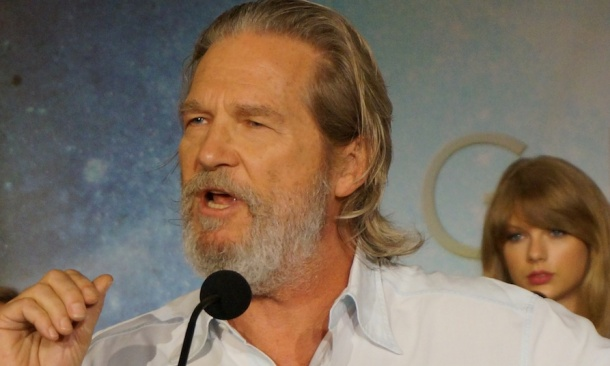"""Jeff Bridges (with Taylor Swift behind him) at the New York press conference for """"The Giver.""""  Photo copyright 2014 Brad Balfour."""