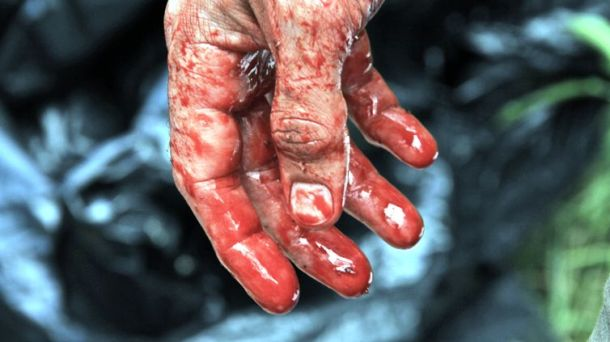 """A bloody hand in """"Exists."""""""