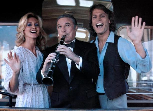 Olivia Newton-John, Gene Kelly and Michael Beck in