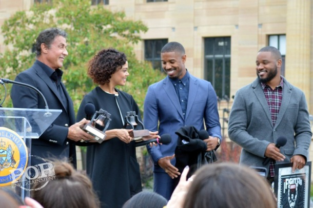 "Sylvester Stallone, Michael B. Jordan, Tessa Thompson and Ryan Coogler at the Philadelphia press conference for ""Creed"" on the steps of the Philadelphia Museum of Art. Photo copyright 2015 Deborah Wagner."