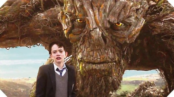 "Lewis MacDougall and Liam Neeson in ""A Monster Calls."""