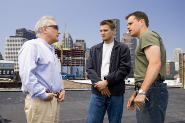 "Director MARTIN SCORSESE discusses a scene with actors LEONARDO DiCAPRIO and MATT DAMON on the Boston location set of Warner Bros. Pictures' crime drama ""The Departed."""