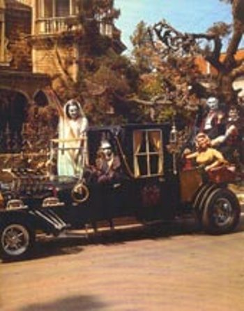 The Munsters in the Dragula Munster Mobile.
