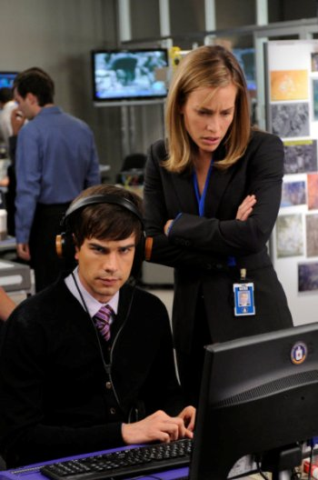 "Chris Gorham and Piper Perabo in ""Covert Affairs."""