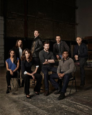 TAKEN -- Season: 1 -- Pictured: (l-r) Brooklyn Sudano as Asha, Monique Curnen as Becca Vlasik, Jennifer Beals as Christina Hart, James Landry Hebert as Rem, Clive Standen as Bryan Mills, Michael Irby as Scott, Gaius Charles as John, Jose Pablo Cantillo as Bernie -- (Photo by: Jeff Riedel/NBC)